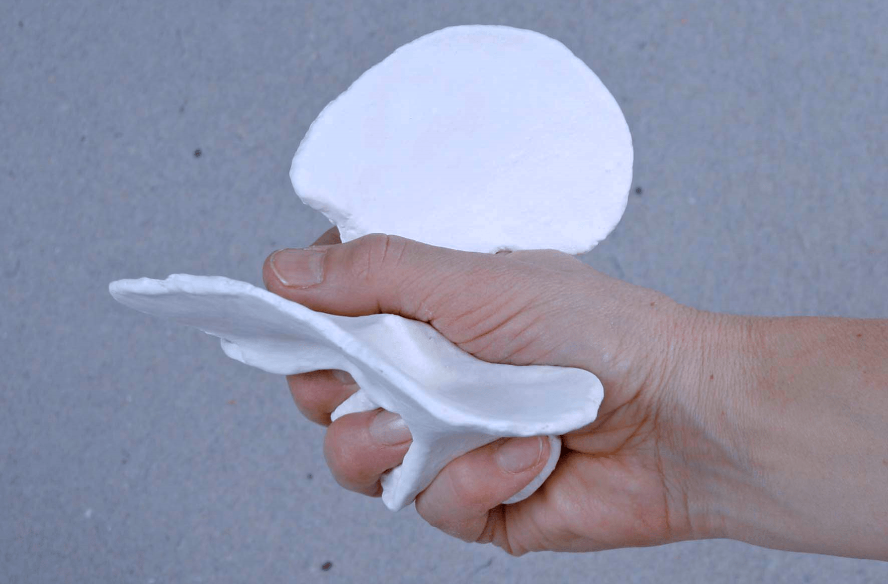 Image 1: 'Grip to get a grip of form'. Photograph demonstrating interaction between the grip and a Hand sketch (porcelain). (Heimer, 2020, cover page).